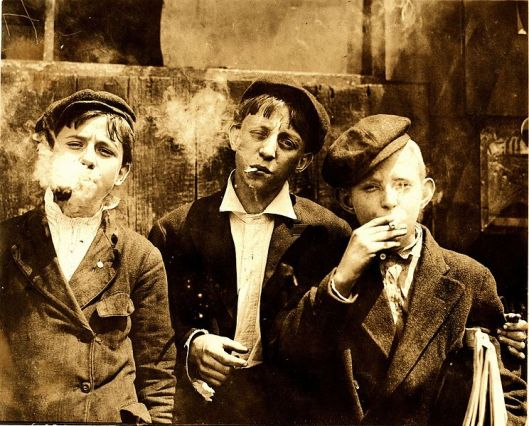 11-00 A. M . Monday, May 9th, 1910. Newsies at Skeeter's Branch, Jefferson near Franklin. They were all smoking. Location- St. Louis, Missouri. .jpg