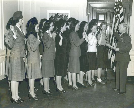 Frank V. McKinless swears in the first Women Marines in the New York area. The induction took place at the Marines' Women's Reserve recruiting office. February 1943
